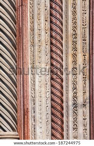 The detail of outdoor facade of church Basilica di Santa Maria del Fiore in Florence, Italy  - stock photo