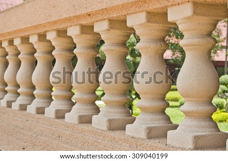 The detail with depth of field of balustrade with beige sandstone Columns. - stock photo