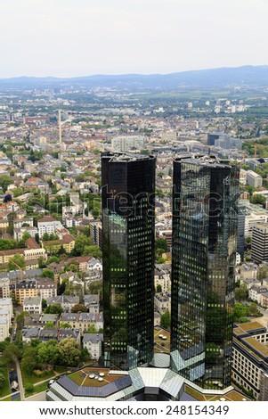 THE DEUTSCHE BANK TWIN TOWERS, FRANKFURT - APR 27: The Deutsche Bank Twin Towers at Frankfurt, Germany on April 27, 2014. It is the headquarters of Deutsche Bank in the banking district of Frankfurt. - stock photo