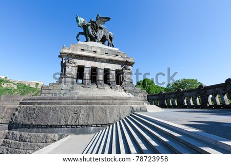 The Deutsches Eck with the statue of German Unity and William the Great in Koblenz. Located at the confluence of the rivers Rhine and Mosel, it is one of the most popular tourist sites in the country. - stock photo