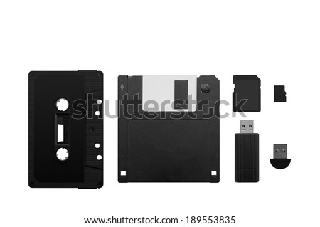 The development of technology of electronic digital memory devices illustrated through vintages and modern equipments. - stock photo