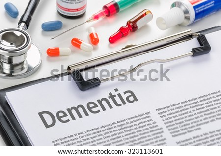 The diagnosis Dementia written on a clipboard - stock photo