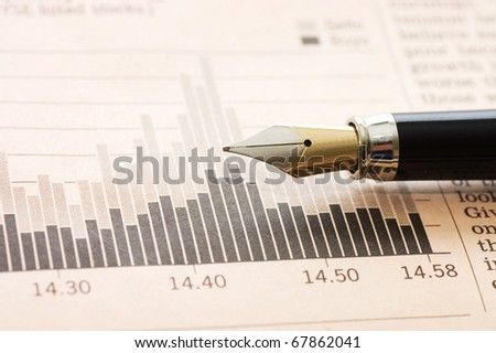 The diagramme and  fountain pen - stock photo