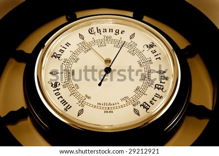 The dial of a barometer is photographed close-up - stock photo
