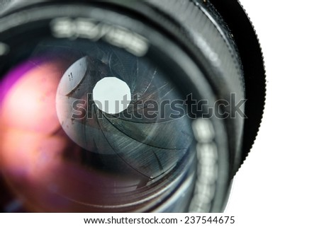 The diaphragm of a camera lens aperture. Selective focus with shallow depth of field. Color toned image - stock photo