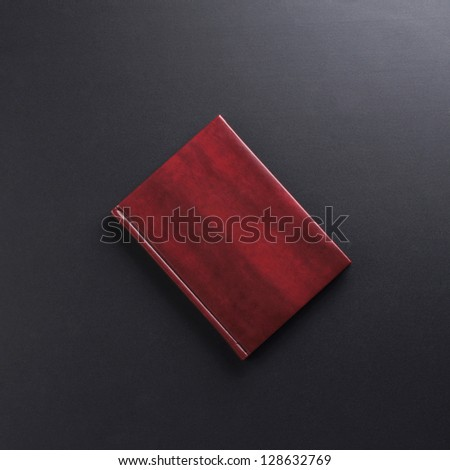 The diary over the black background - stock photo