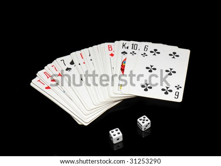 The dice and playing cards on black  background. - stock photo