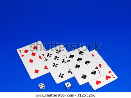 The dice and playing cards on blue background. - stock photo