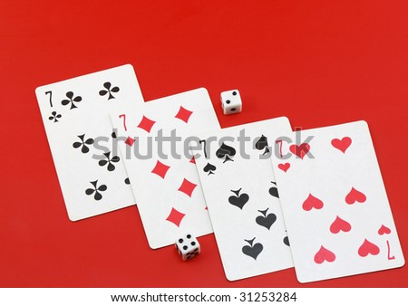 The dice and playing cards on red  background. - stock photo