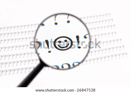 the different symbols under magnifying glass on a white paper