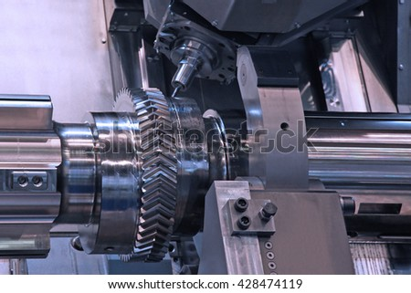 The difficult part with an eccentric processing on lathe in workshop - stock photo