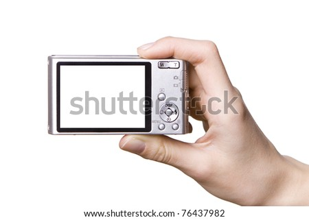 The digital camera in a hand, isolated on white - stock photo