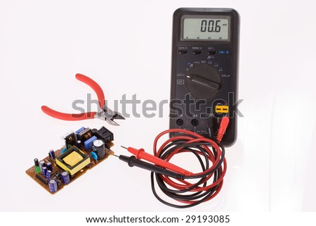 the digital multimeter and electronics components - stock photo