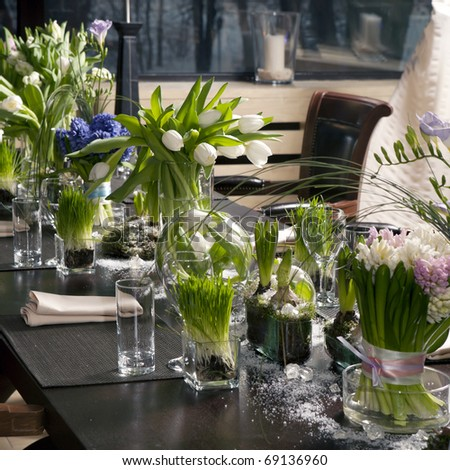 the dining table was decorated with the tulip  flower for the romantic time - stock photo