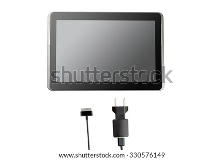 the discharged tablet with charger isolated on white background - stock photo