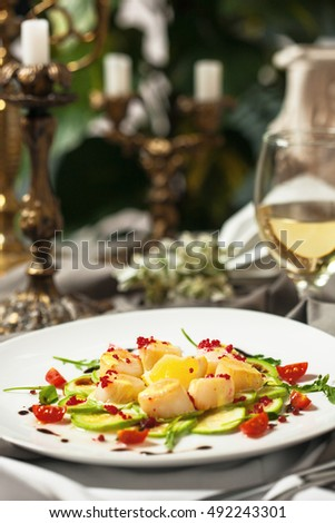 The dish is a delicacy from the sea scallops with lemon slice served in the restaurant