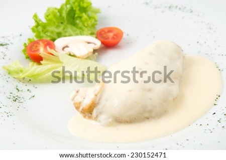 the dish of grilled chicken in cream sauce and garnished - stock photo