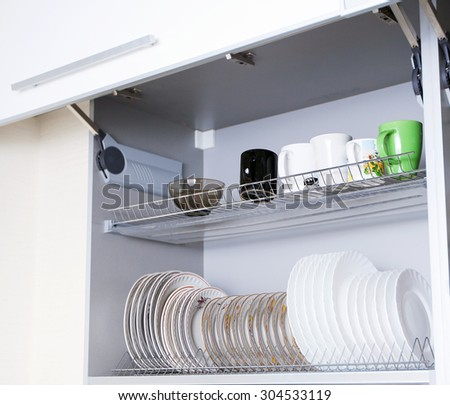 the dishes in the cupboard - stock photo