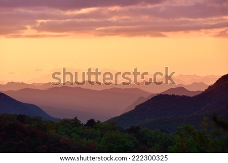 the distant mountains in the mist - stock photo