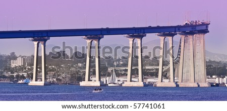 The distinctive curve and soaring sweep of the San Diego-Coronado Bridge was the first structural conquest of San Diego Bay, joining the Island of Coronado and City of San Diego. - stock photo