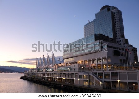 The distinctive sails of Canada Place, Vancouver's Trade and Convention Center as well as it's cruise ship terminal at dawn. British Columbia, Canada. - stock photo