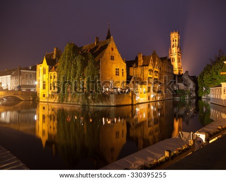 The dock of Rosary - Rozenhoedkaai - and Belfort Tower at night, Bruges, Belgium