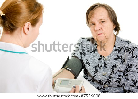 The doctor and an elderly woman with a sphygmomanometer on a white background.
