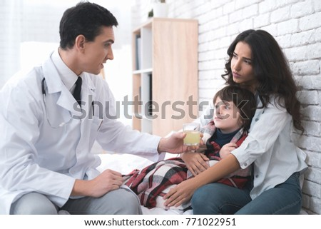 The doctor came home to a sick 10-year-old boy. The boy has a cold. The doctor inspects him to know what he was sick of.