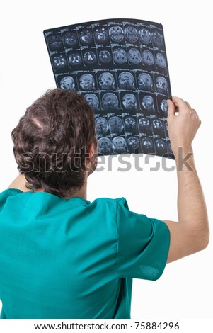 The doctor examines the patient's x-rays on a white background
