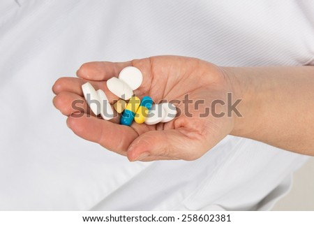 The doctor gives just the pills that is necessary - stock photo
