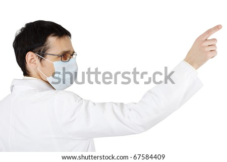 The doctor in a medical mask points a finger on white