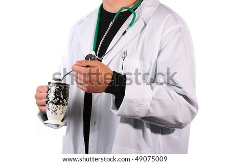 The doctor in a white dressing gown with a stethoscope has control over a cup and a spoon. - stock photo