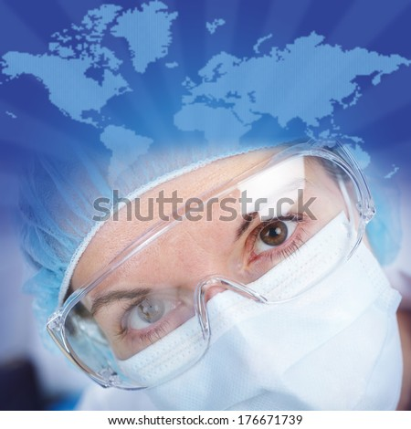 The doctor in gspectacles and in a mask in a laboratory - stock photo