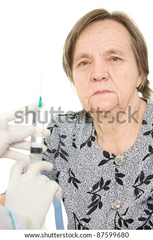 The doctor makes vaccination an old woman. - stock photo