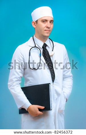 The doctor man on a blue background with a folder - stock photo