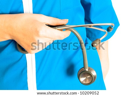 The doctor with a stethoscope in hands - stock photo