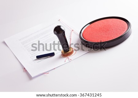 The document signed by a notary public with his stamp on a white background - stock photo