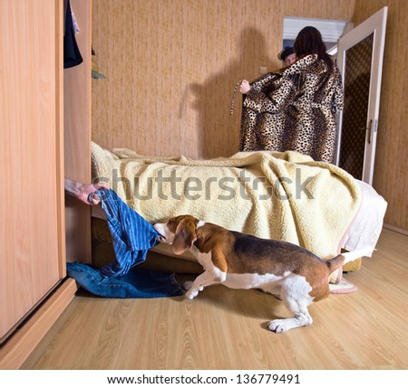 The dog has found the lover in a wardrobe