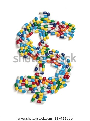 The dollar symbol made out of colorful pills isolated on white. - stock photo
