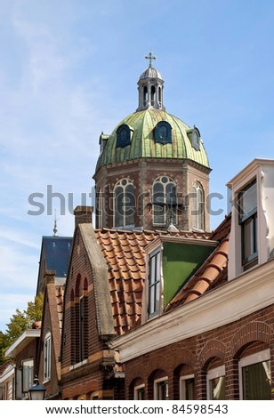The dome of a monumental church in Hoorn, the Netherlands, viewed from a nice old residential street. - stock photo