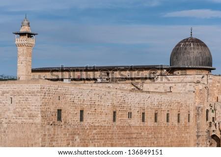 The dome of Al-Aqsa mosque (right) and the Al-Fakhria minaret, Jerusalem, Israel. - stock photo