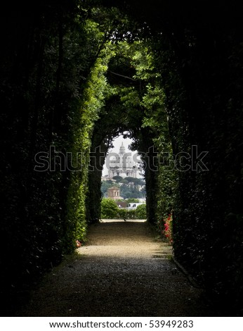 The dome of Saint Peters Basilica seen through the famous keyhole at the Villa Malta. Rome, Italy, Southern Europe - stock photo