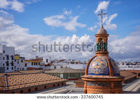 The dome of the chapel El Carmen and the roofs of Seville, Spain