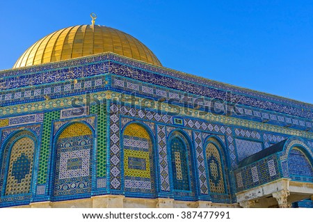 The Dome of the Rock decorated with colorful glazed tiles, covered with geometric islamic patterns and Quranic calligraphy, Jerusalem, Israel.