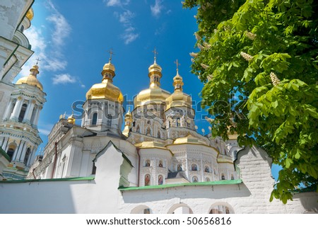 The domes of Peshtersk Lavra - a shot from behind the wall - stock photo