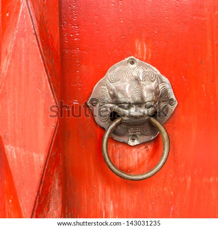 The door handles are red with lion heads. - stock photo