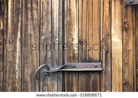 The door hook closes an old wooden door. Textural wooden background  - stock photo
