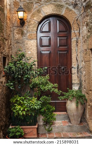 The door in the alley of the old Tuscan town, Italy - stock photo