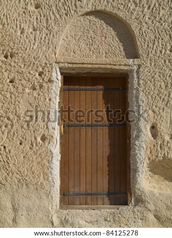 The door in the town Goreme with rock houses - stock photo