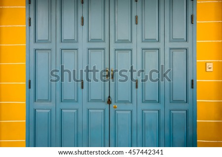 The door is color blue cut off yellow was locked , Copy space and empty: ideal use for background.